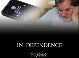 """Image Description: A iPhone showing a person's contact info with a man looking at something off screen. He has his hand on his check and is looking at the off image item intently. On the bottom of the image is the title, """"In Dependence."""" In addition, you can see two festival laurels that are unrecognizable."""